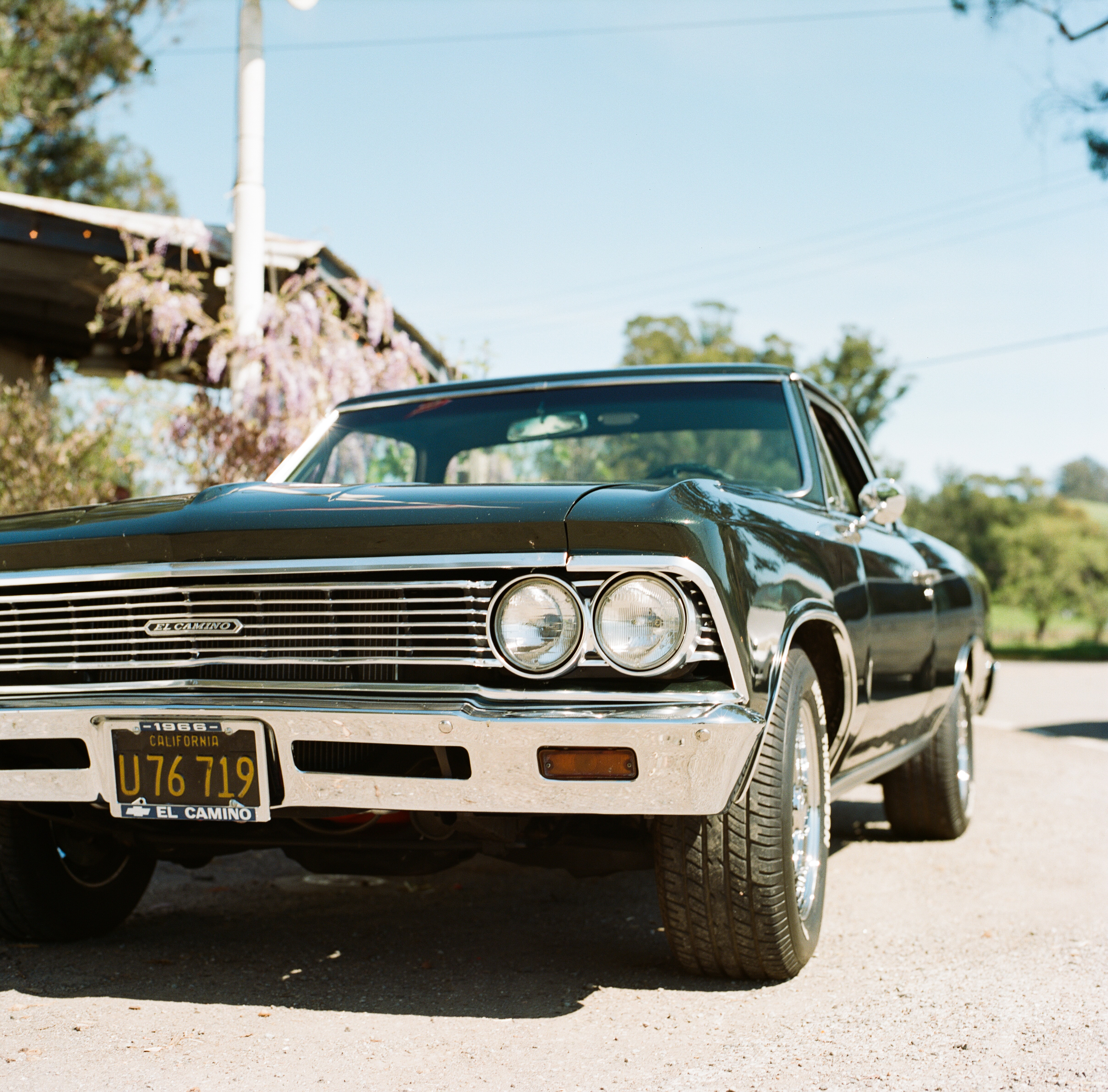 The front view of an el Camino impala showing the headlights and the bumper