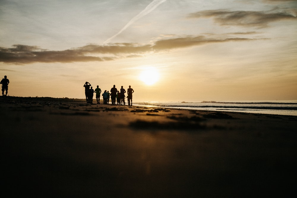 silhouette of people at seashore