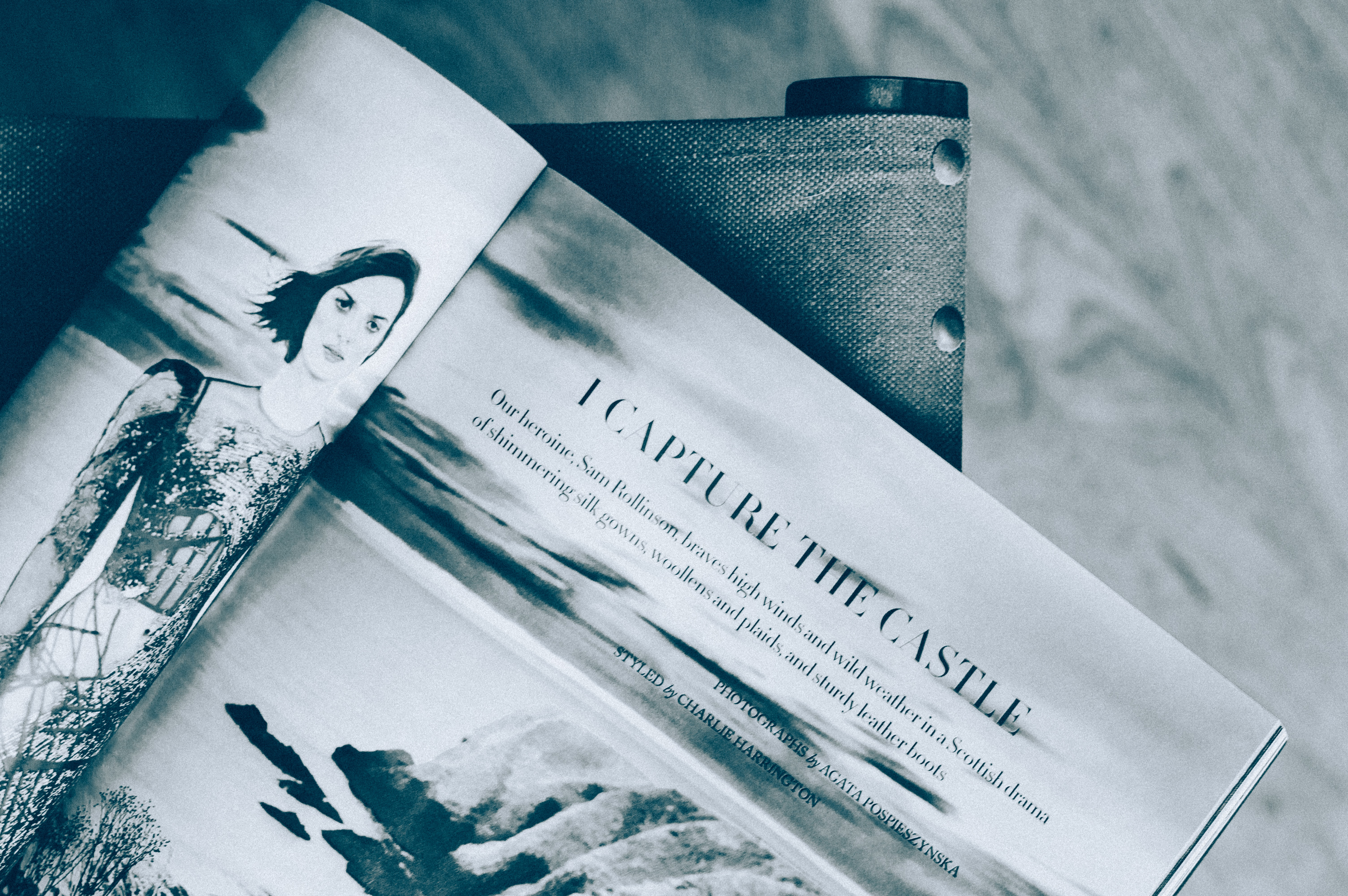 A monochrome shot of a magazine on a chair