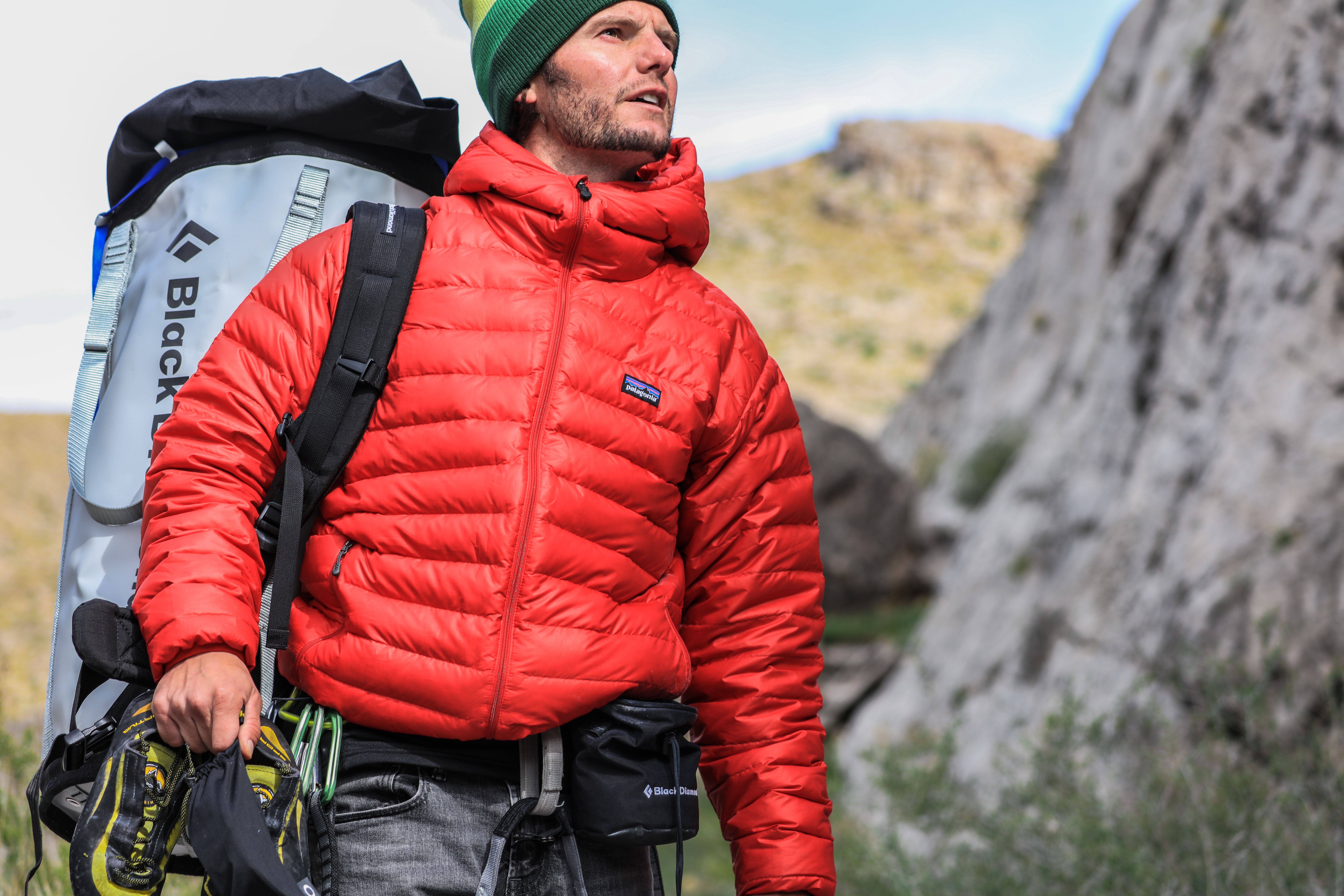 man looking above carrying gray camping backpack