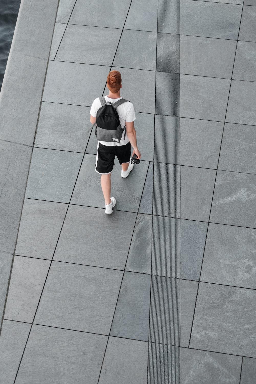 man walking on focus photography