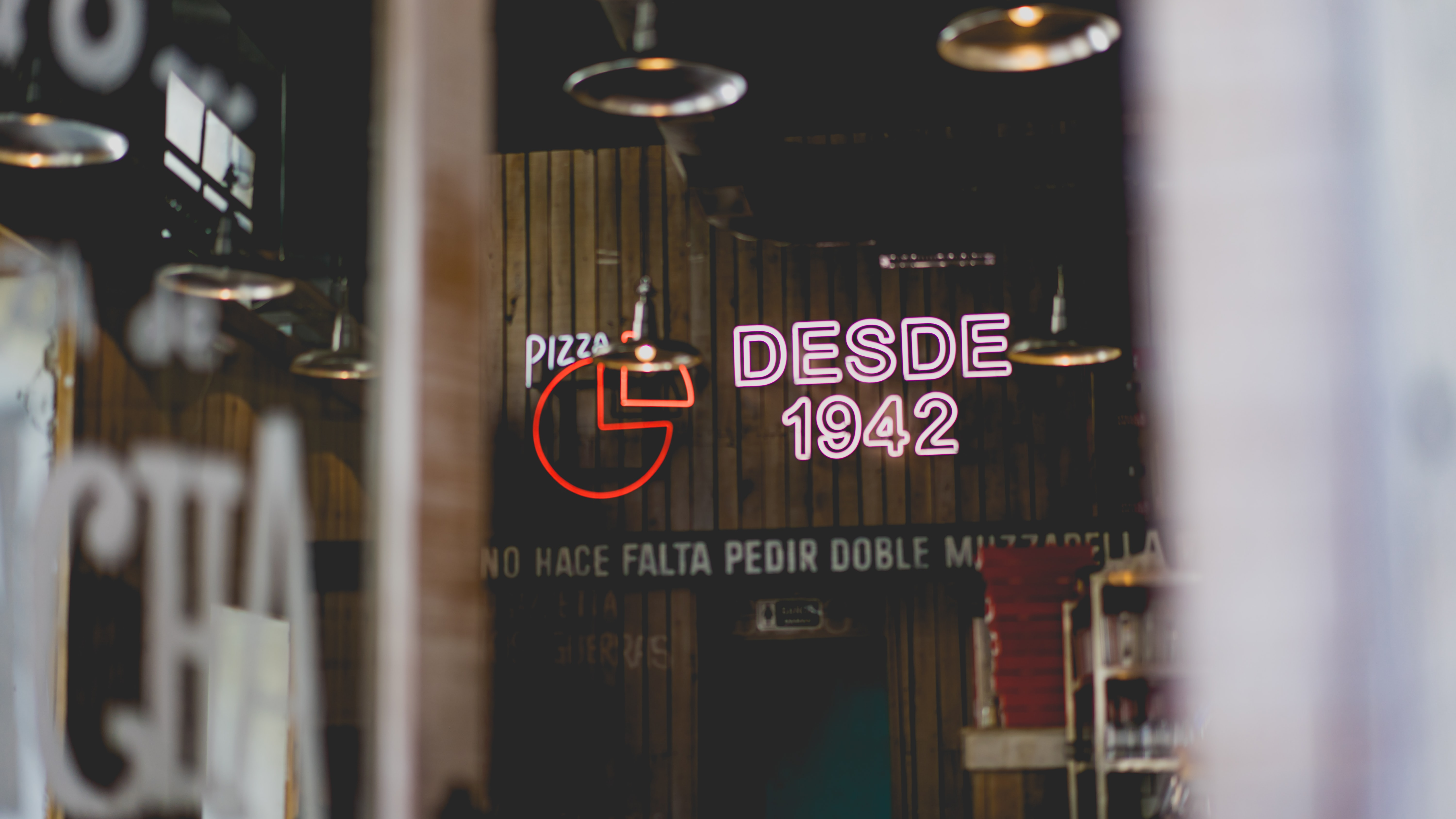 selective focus photo of desdes 1942 neon light signage