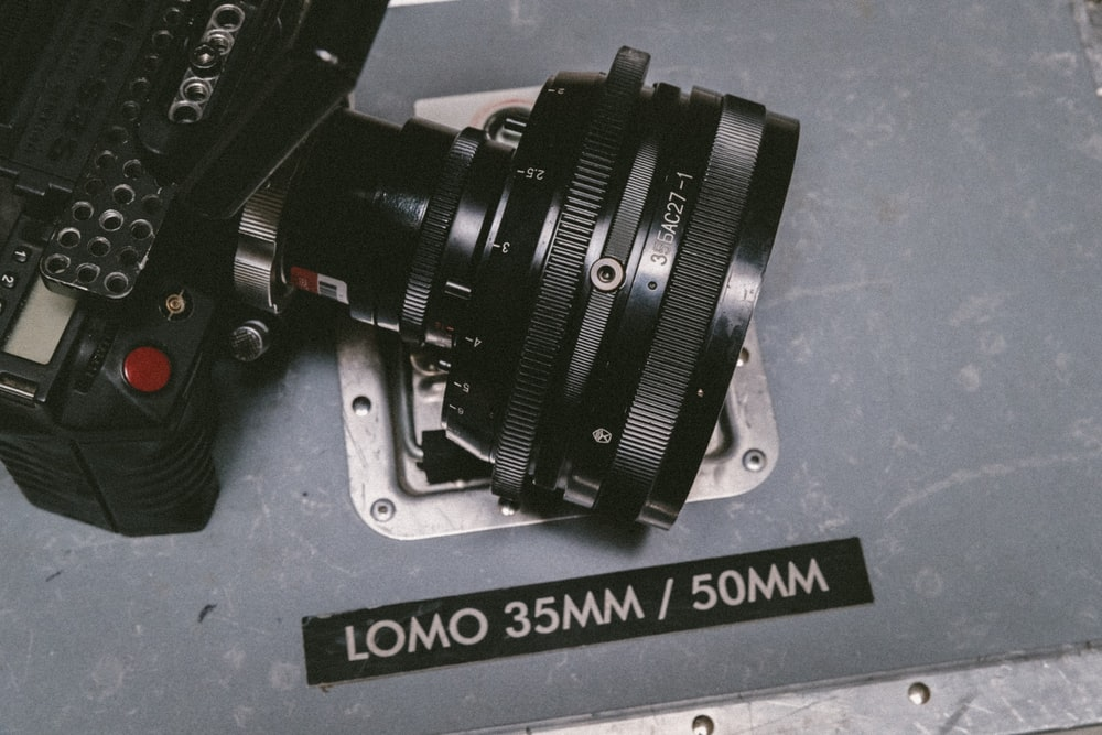 black Lomo DSLR camera on gray floor surface