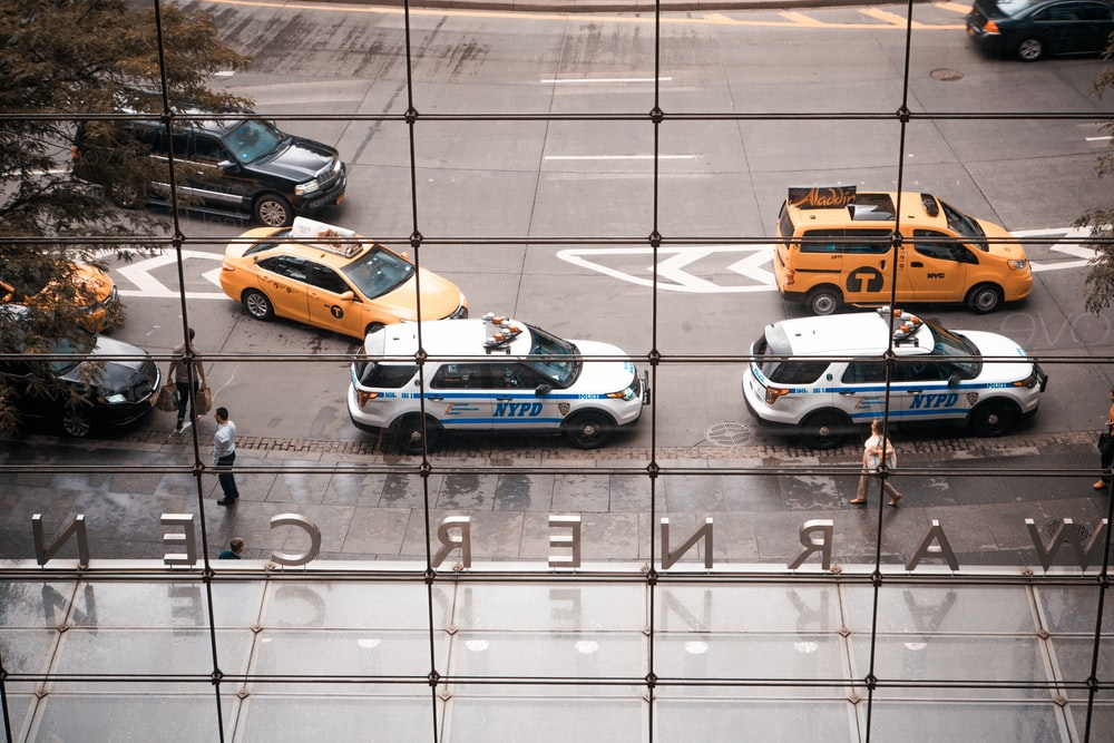 two parked NYPD vehicles