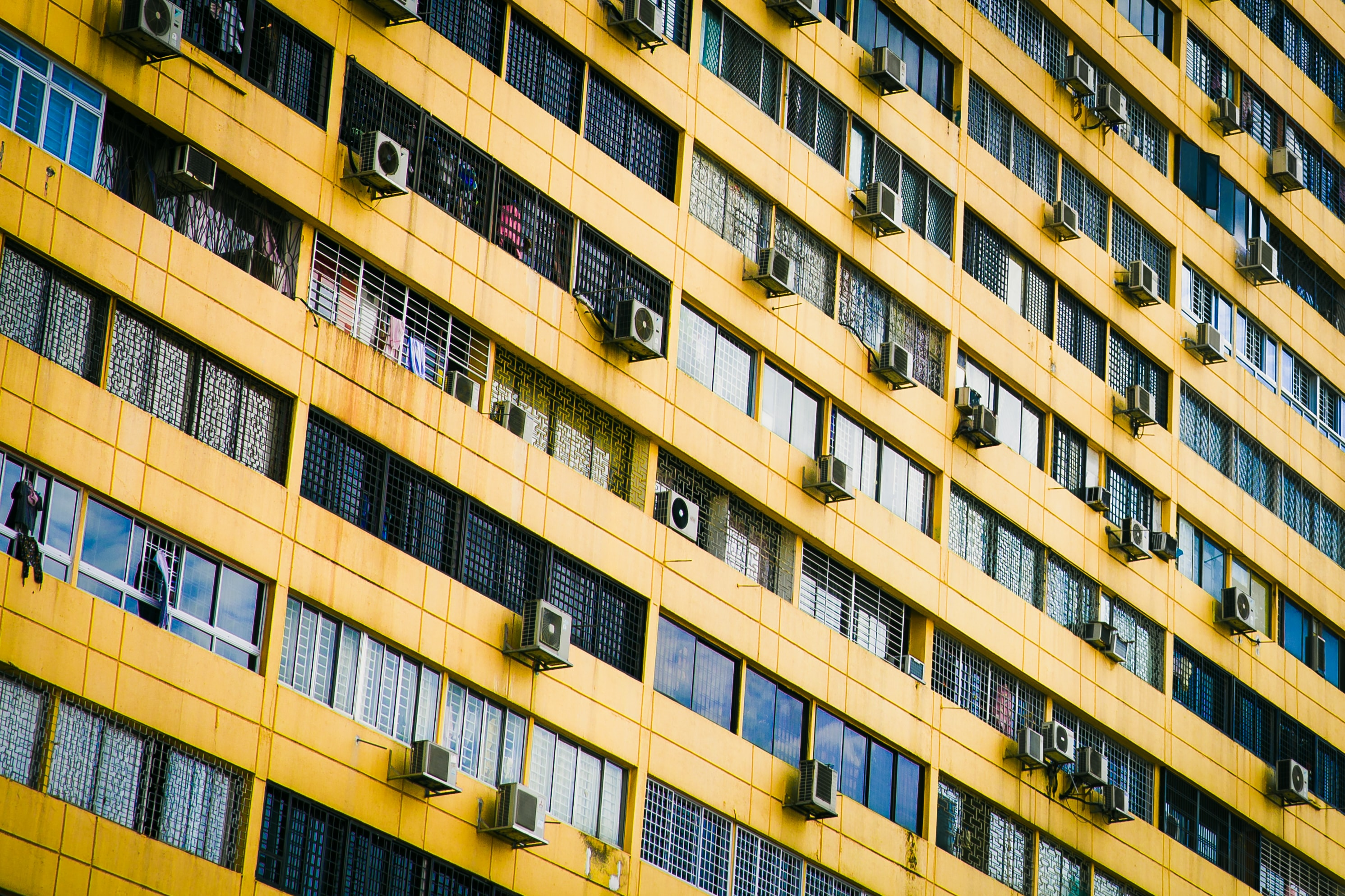 Apartment building with yellow wall.