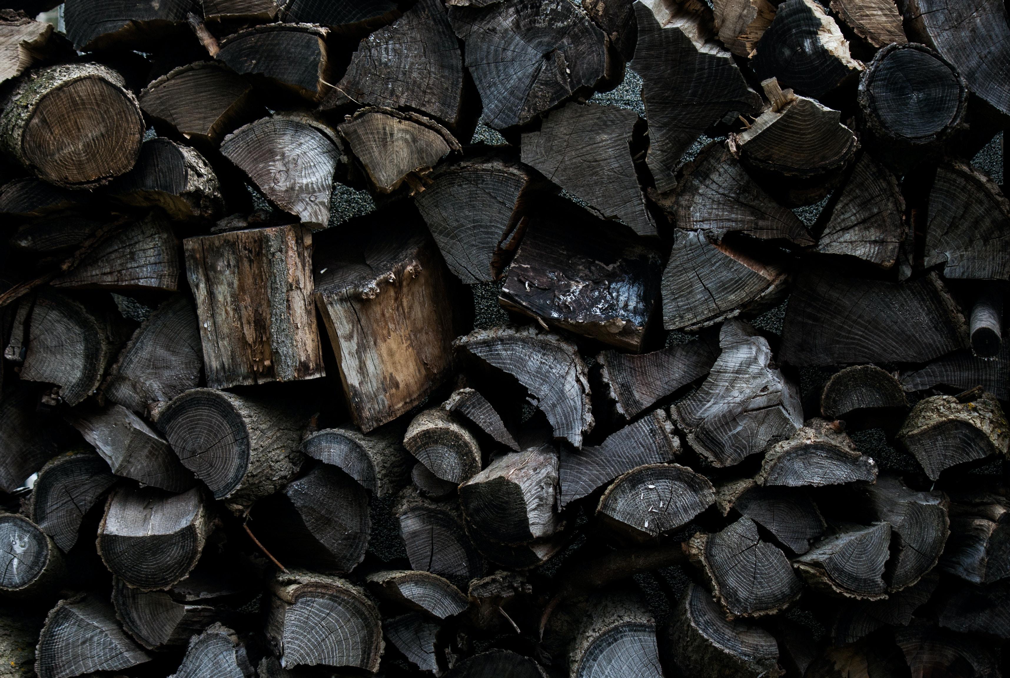 A pile of dark brown firewood