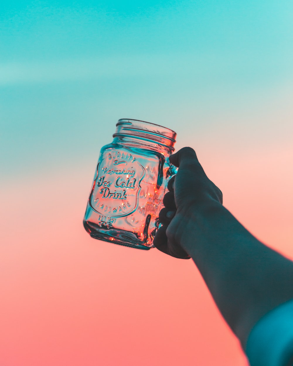 closeup photo of person's holding jar