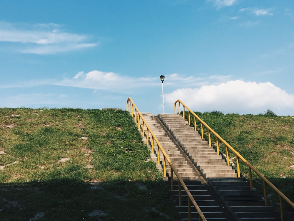 brown concrete stairs under clear blue sky
