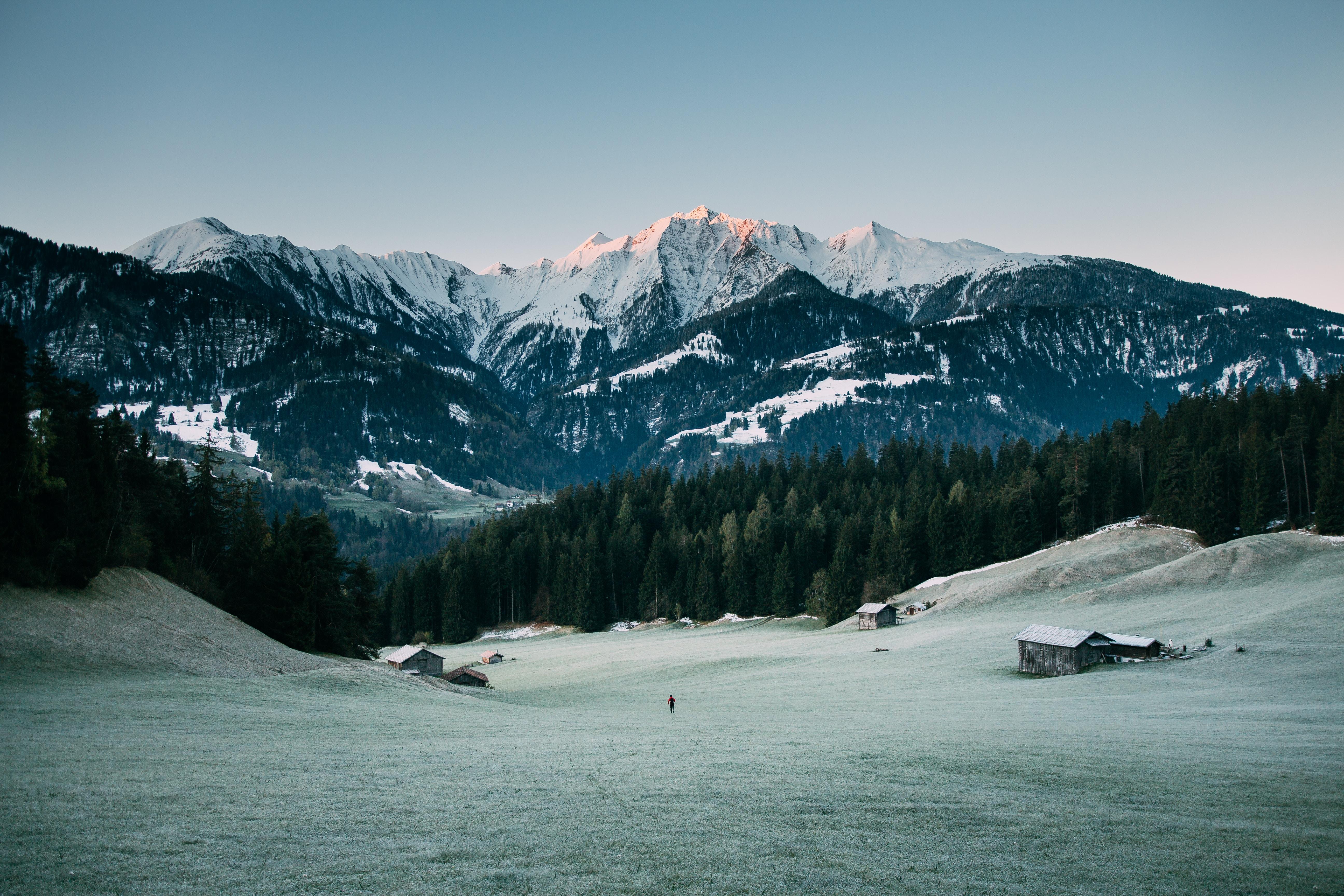 house on snow field beside mountain