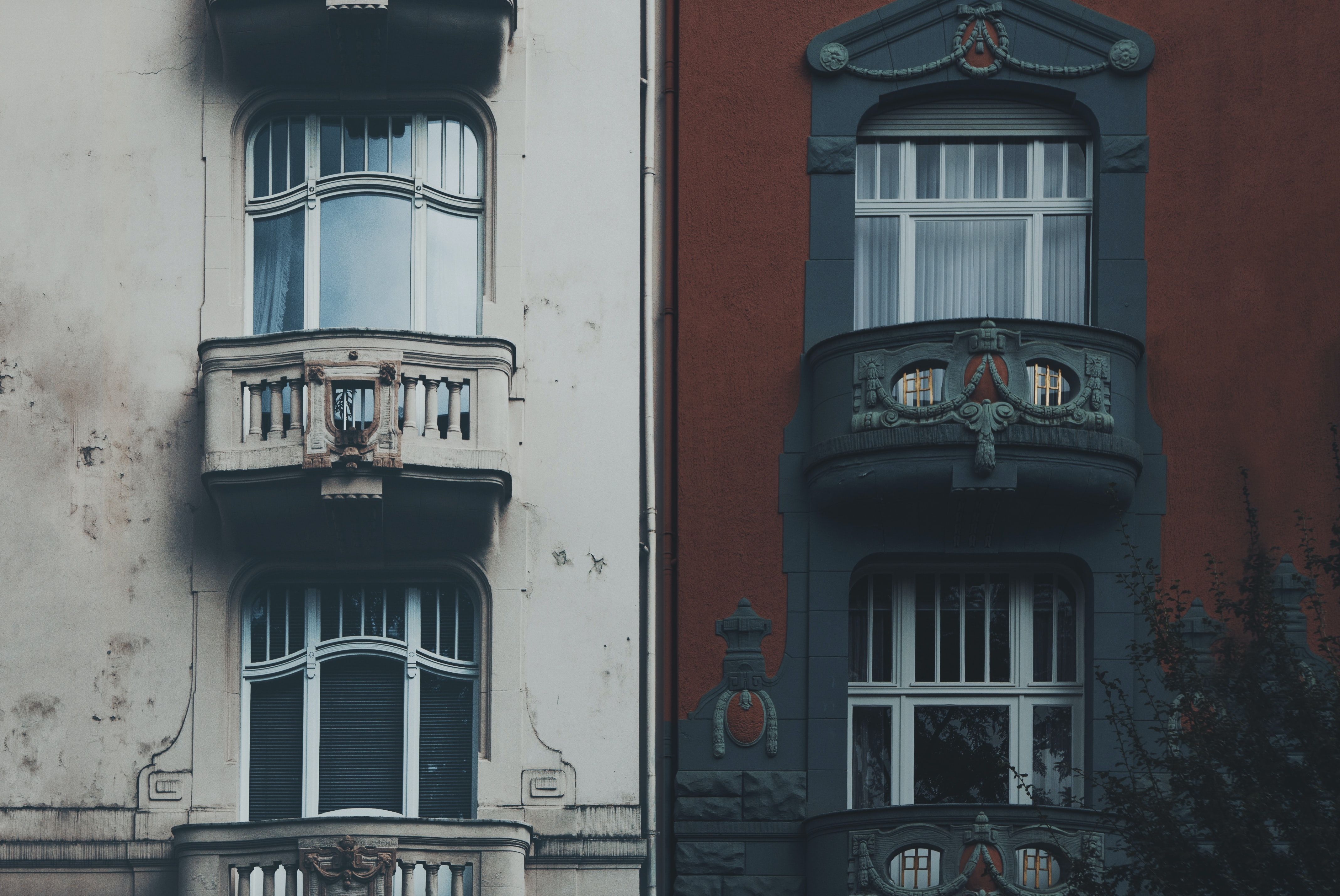 closed glass balcony doors of two buildings