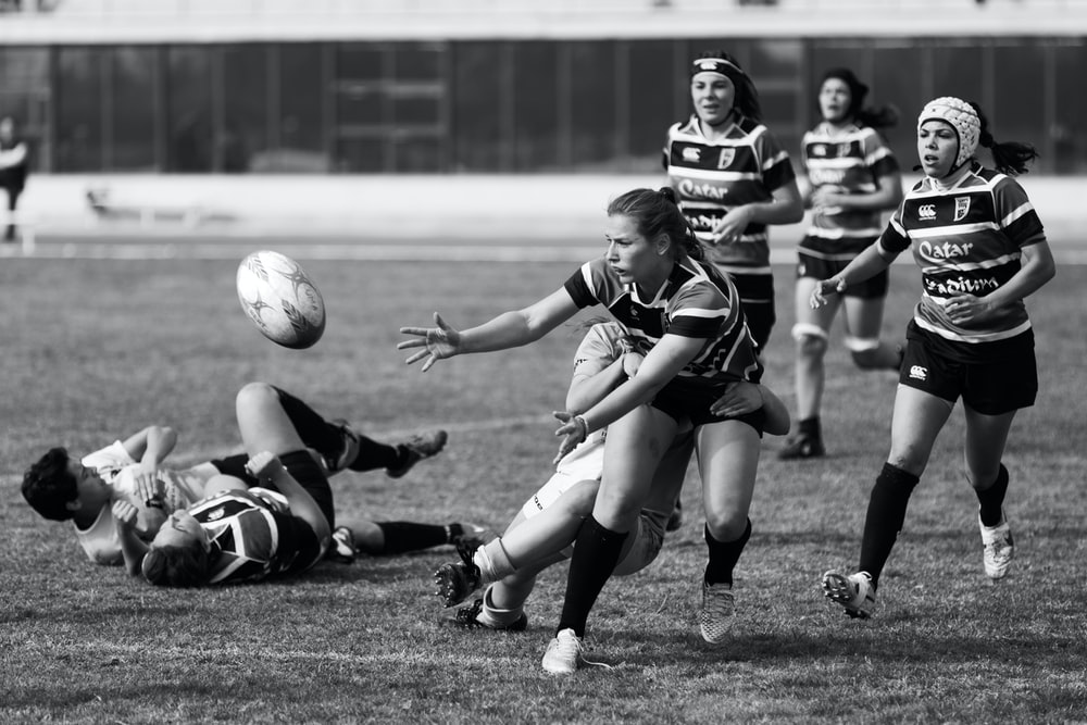 grayscale photo of a woman playing soccer