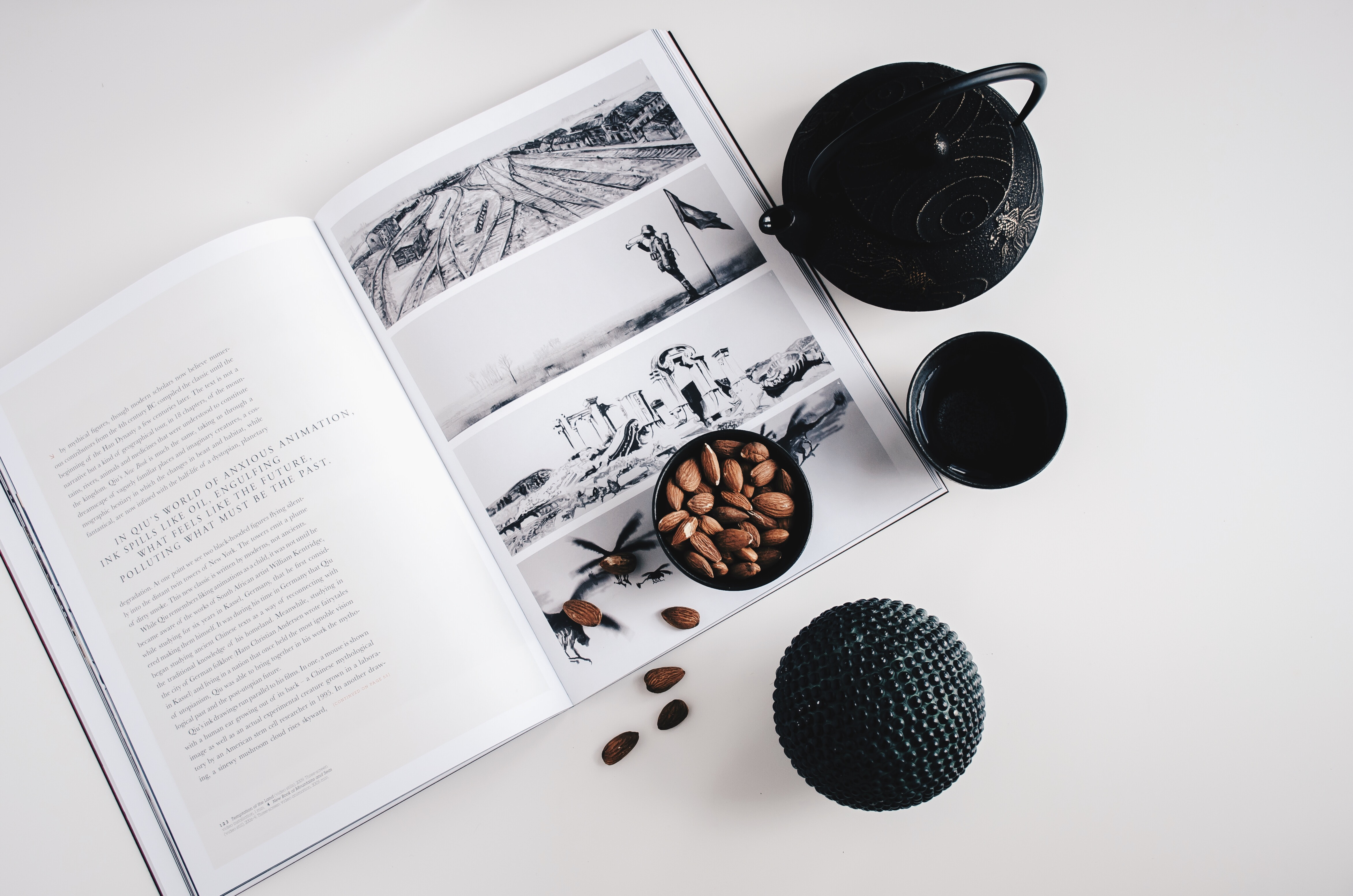 An overhead shot of a bowl of almonds on a book