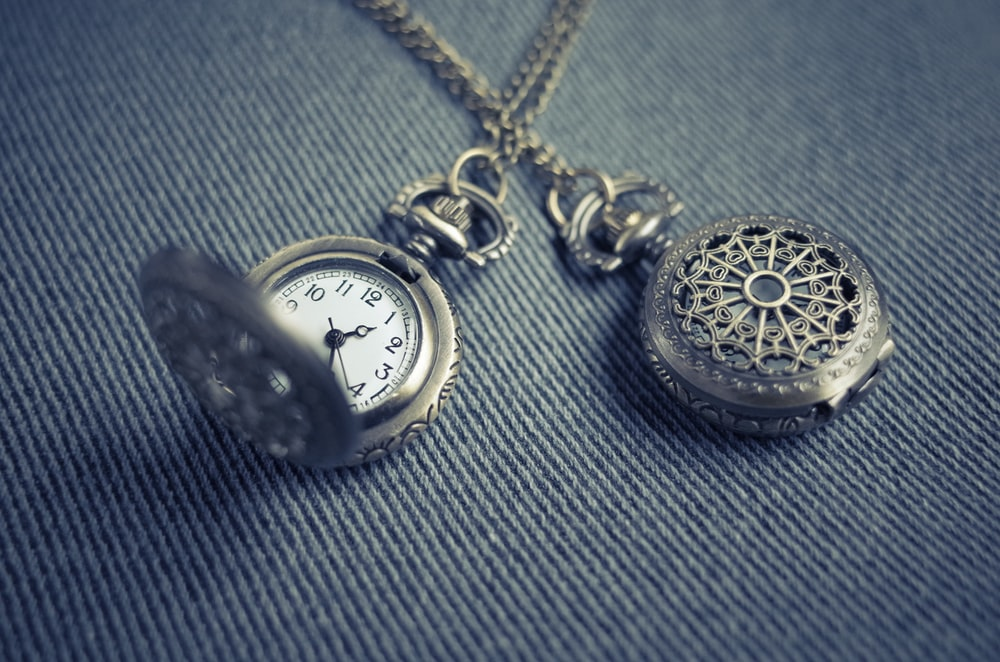 silver-colored stopwatch pendant