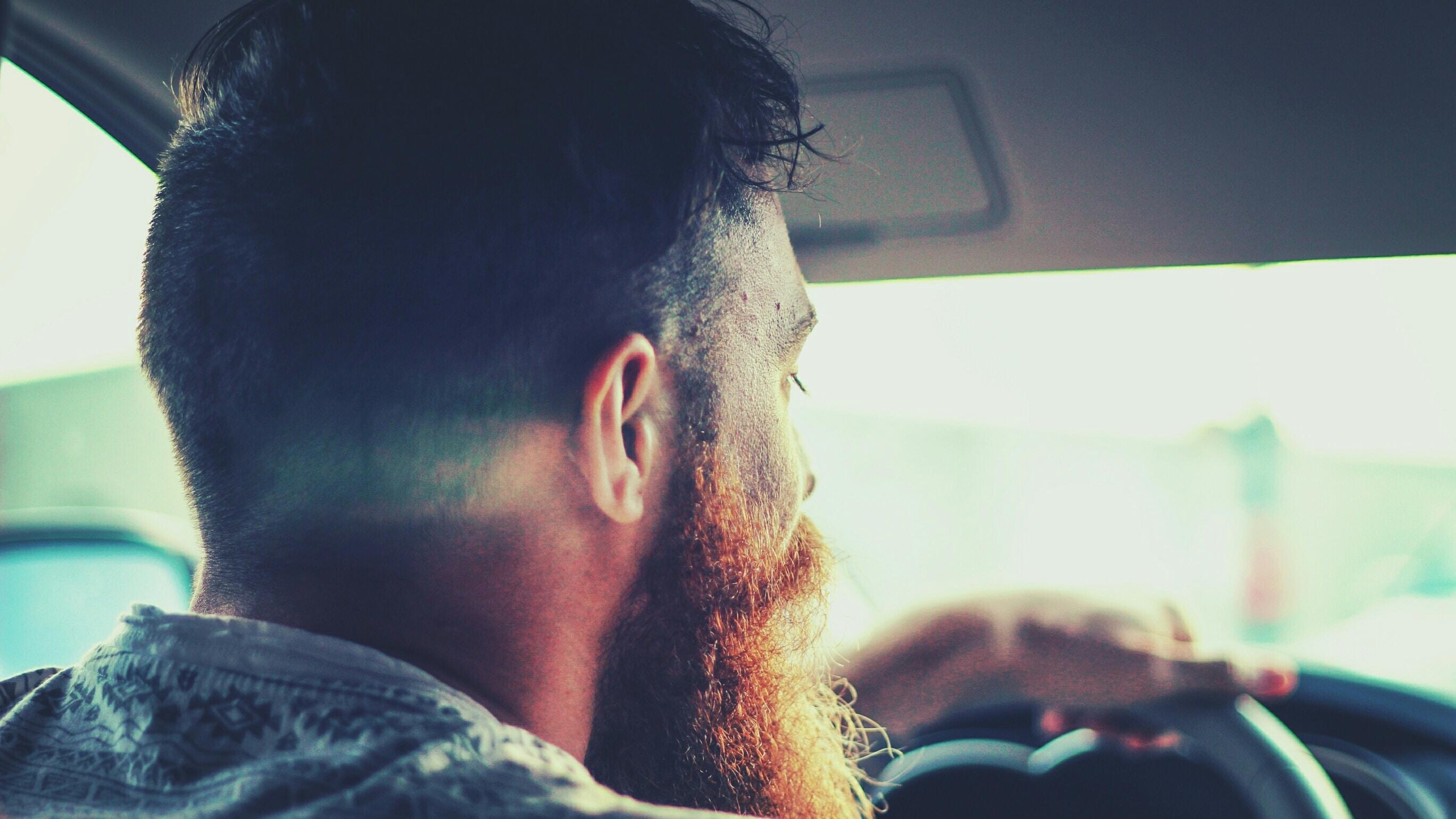 A man with a beard drives a car in Las Vegas
