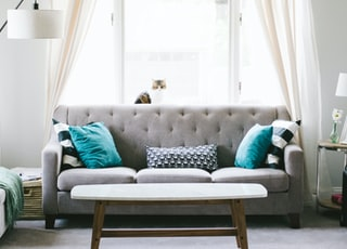 brown and white wooden table beside sofa chair
