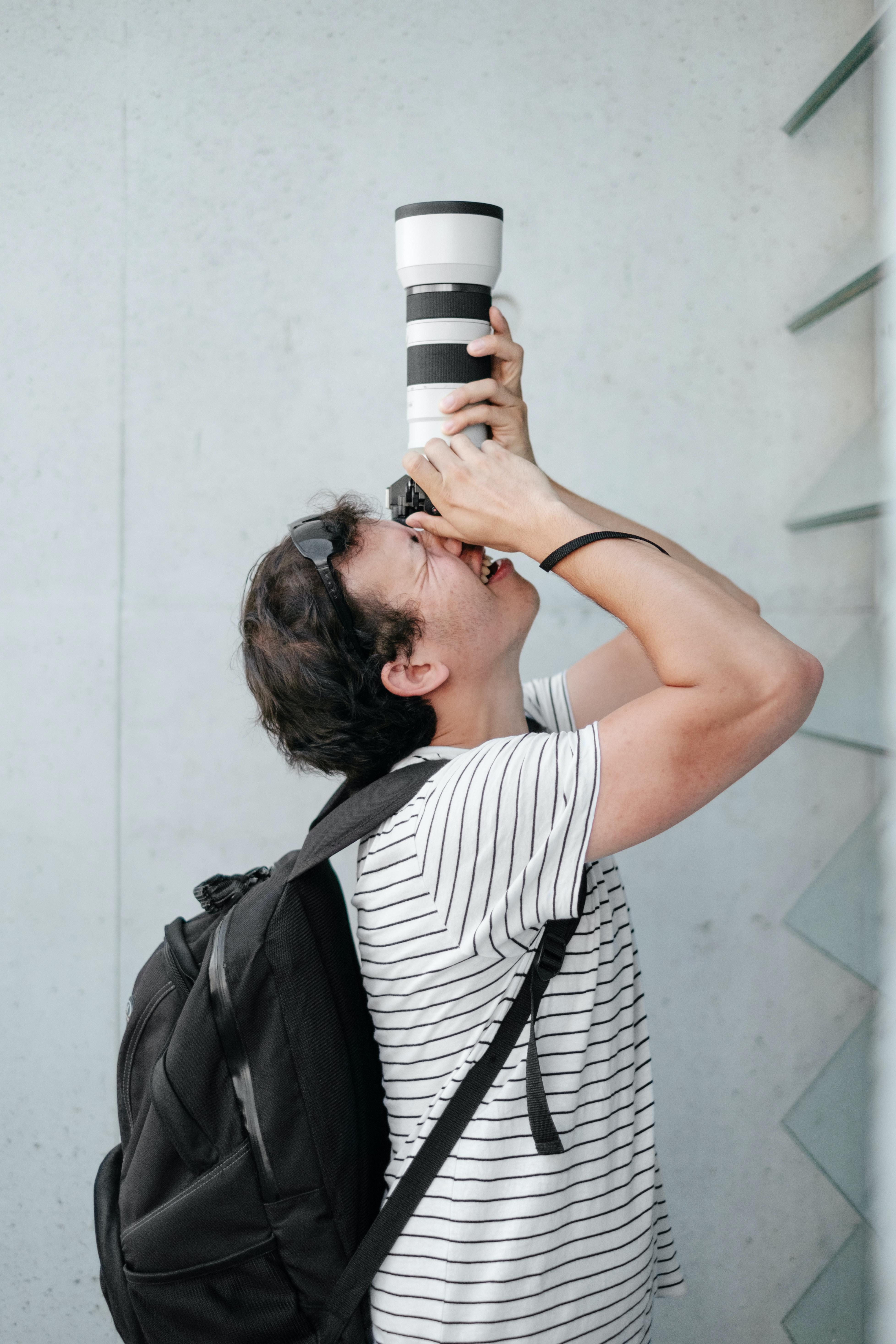 person using black and white DSLR camera