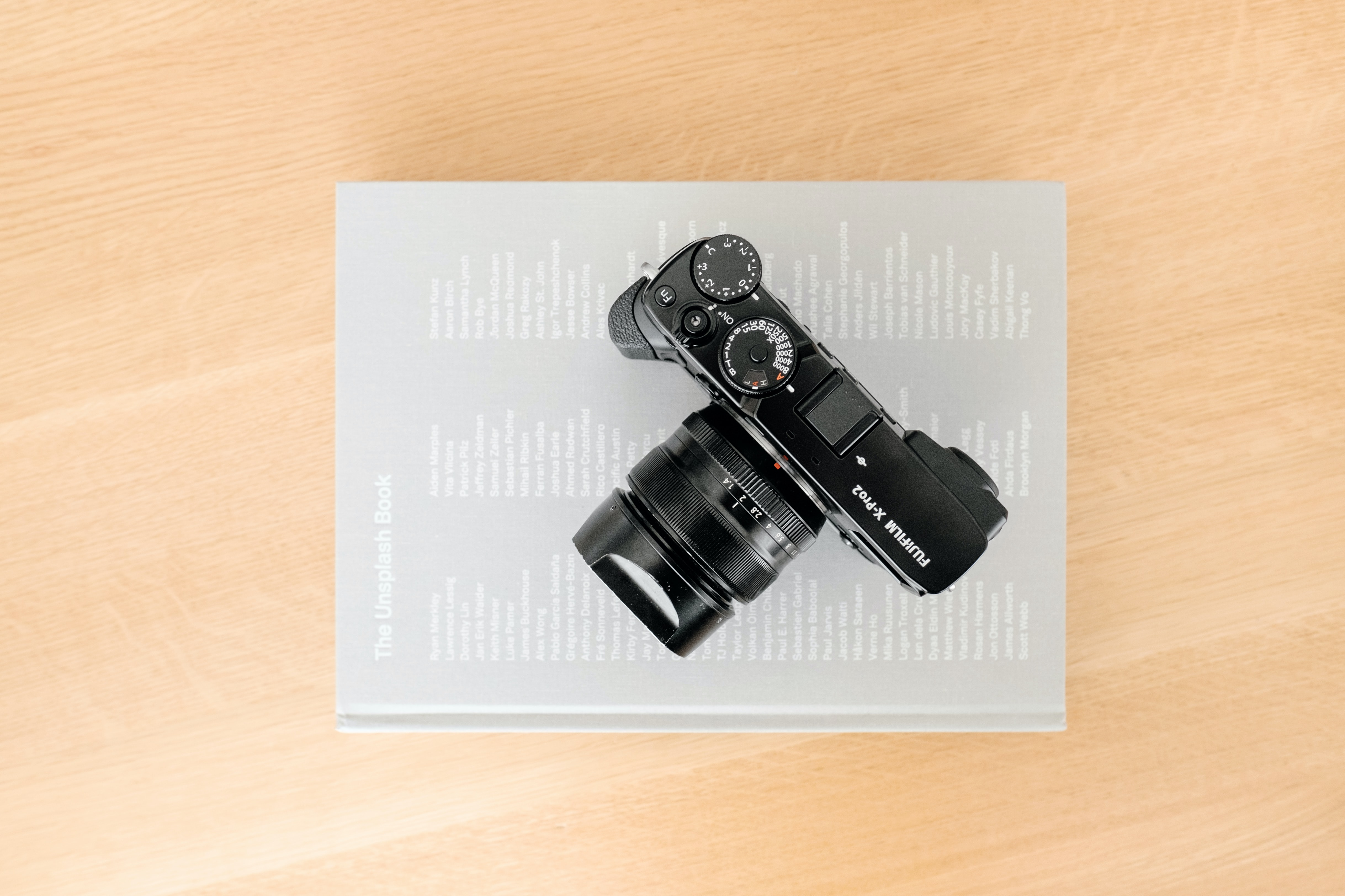 Fujifilm camera on gray book on a desk