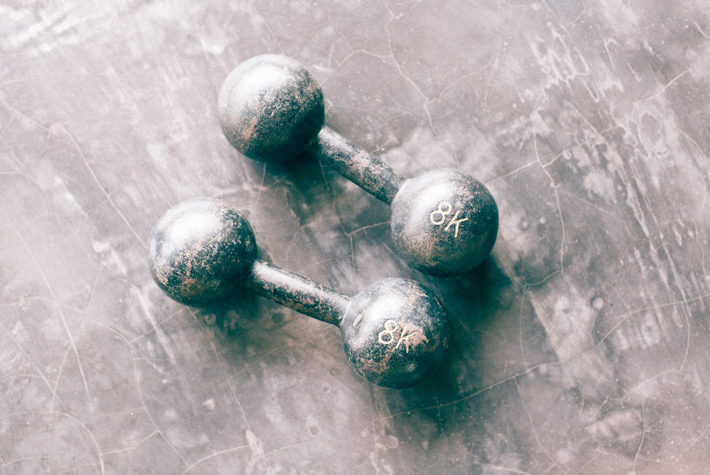 two gray dumbbells