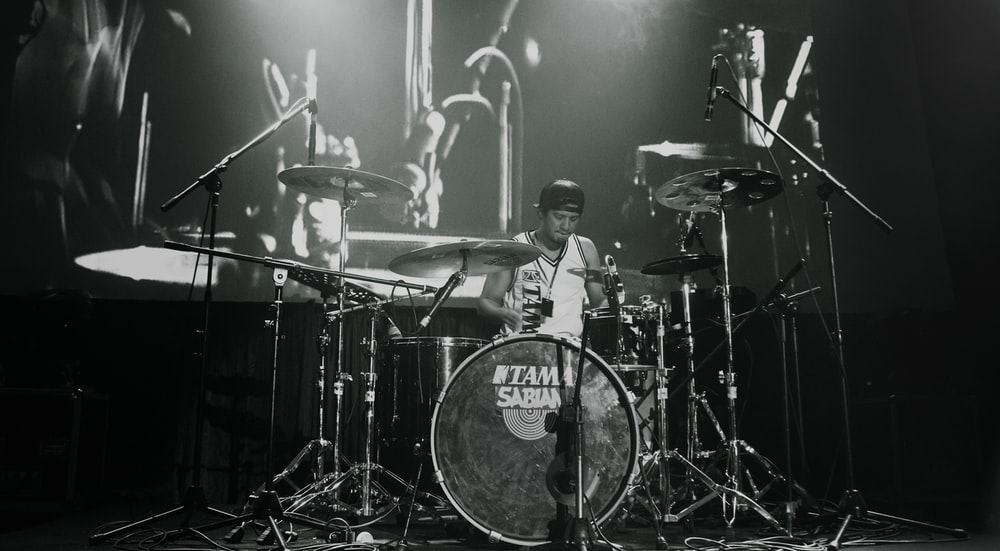 man playing drum set