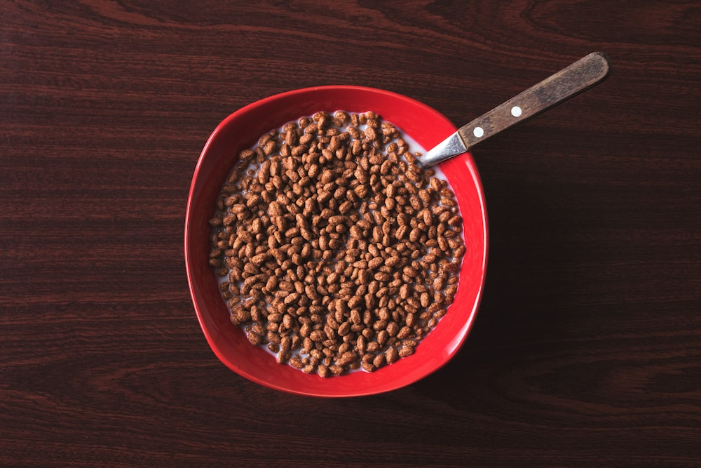 bowl of cereal with spoon on tabletop