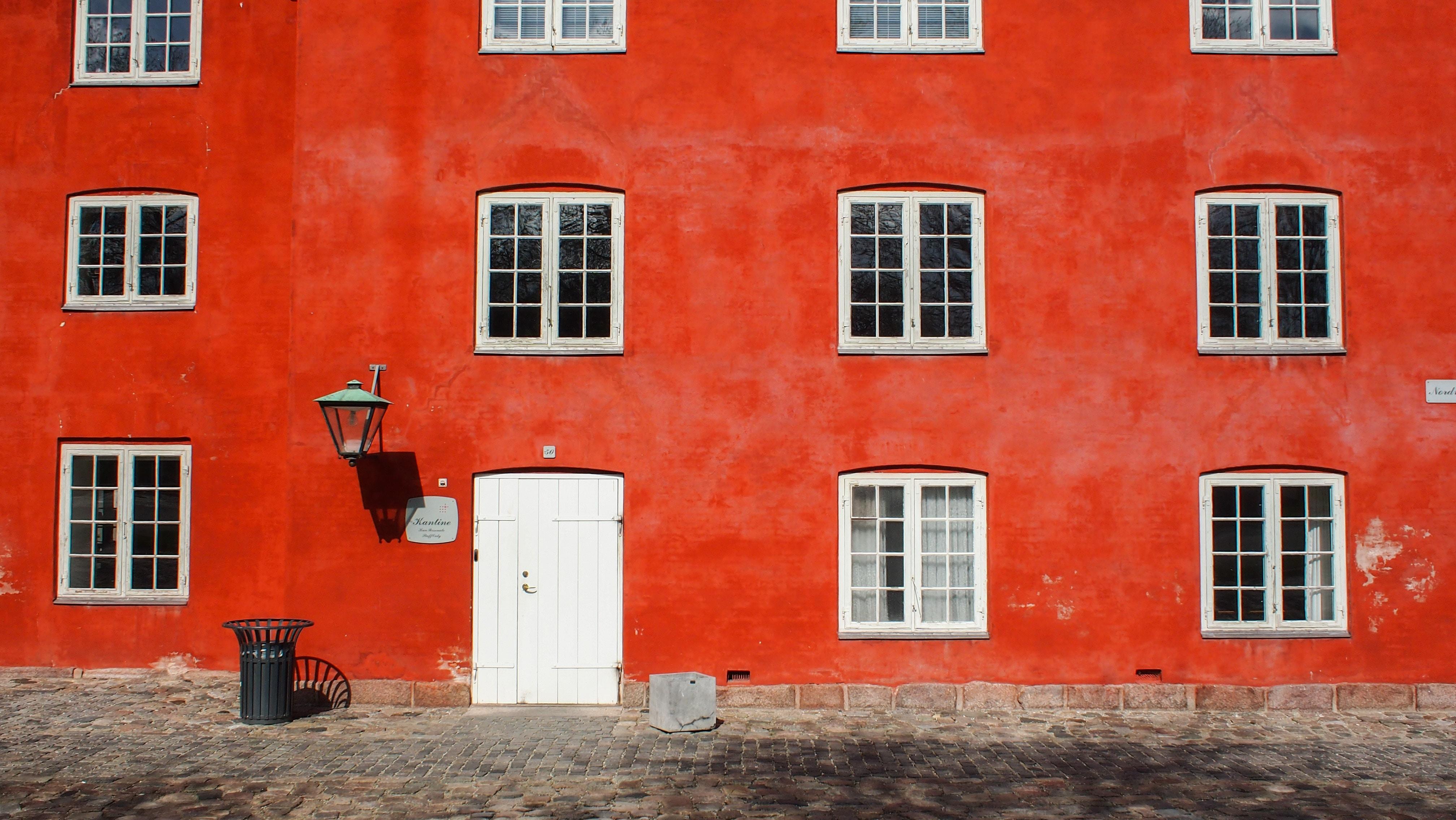 closeup photo of red concrete building