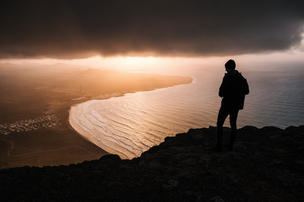 silhouette of person looking at the horizon