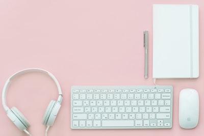 White gear on pink flatlay