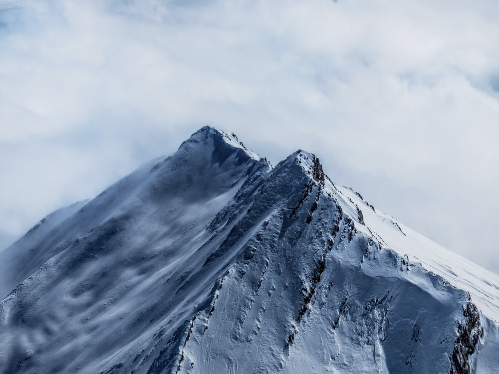 white fogs on mountain filled with snow