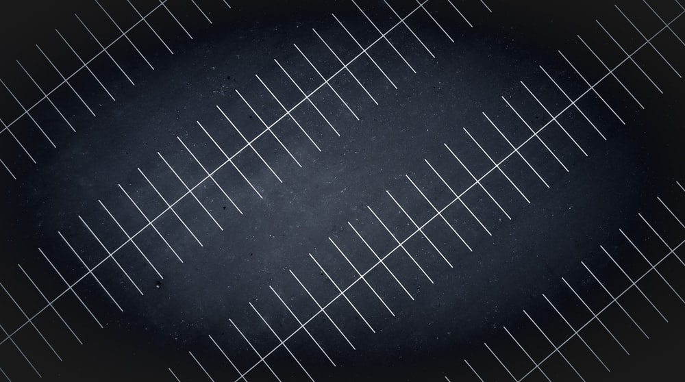 A drone view at night of parking lot lines