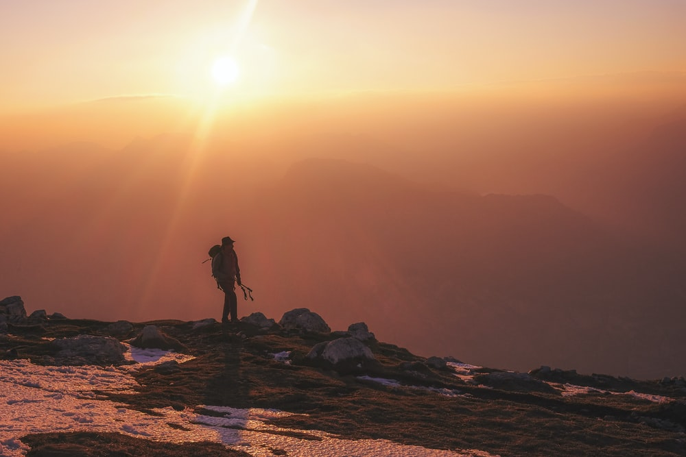 man hiking during daytime