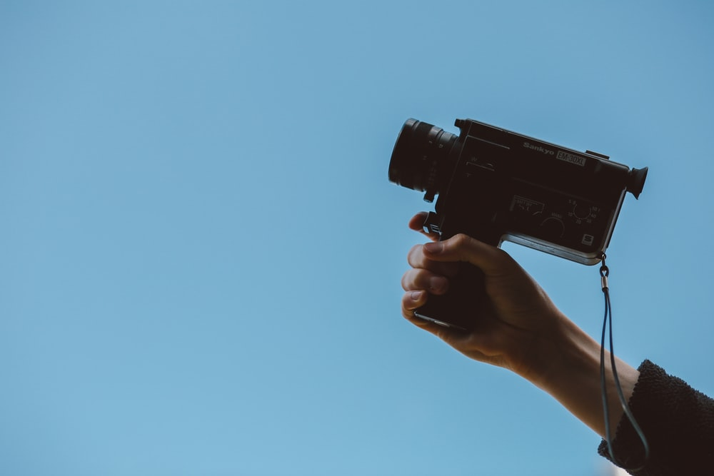 person holding video camera