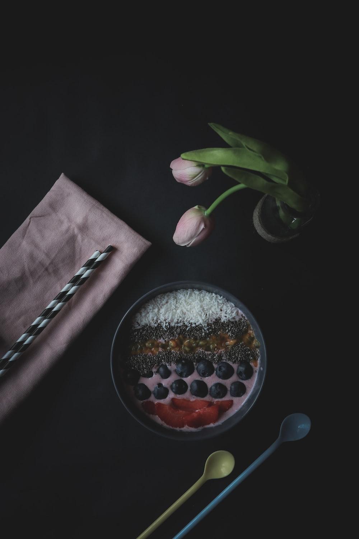 pink tulip flower beside pink textile