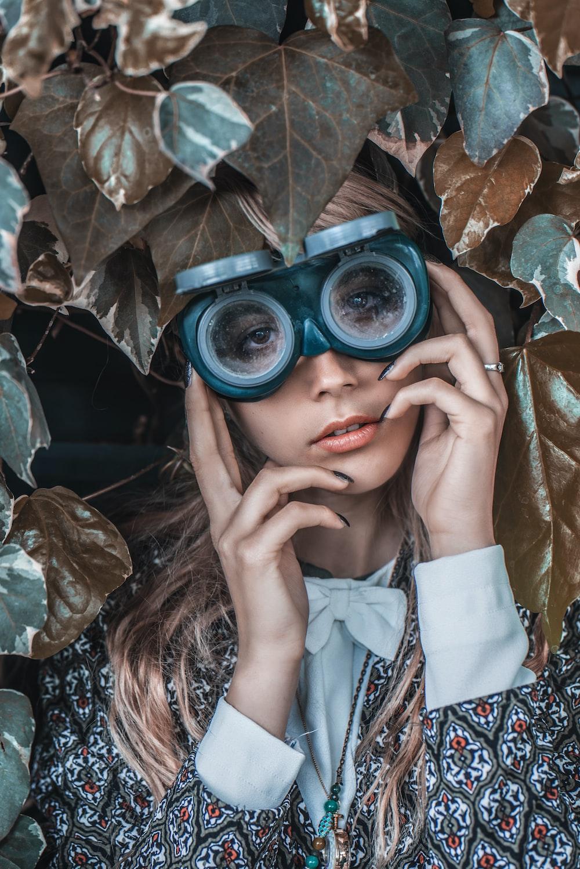 woman wearing black binoculars