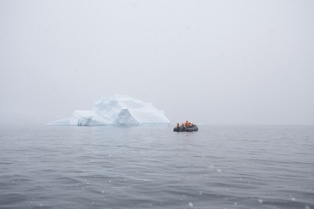 inflatable boat near iceberg