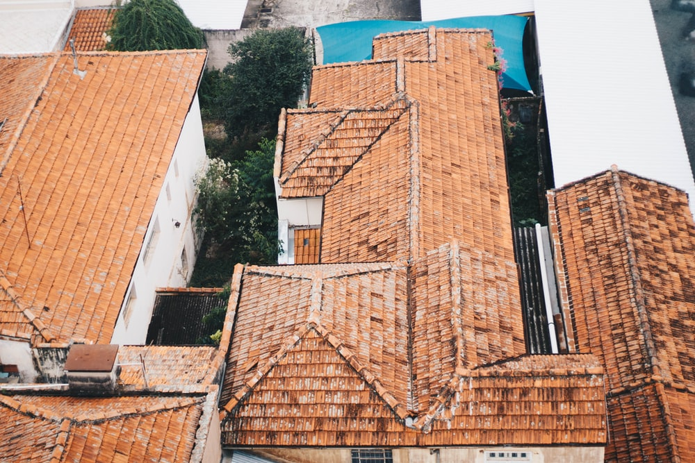 bird's eye view photography of brown roof shingles