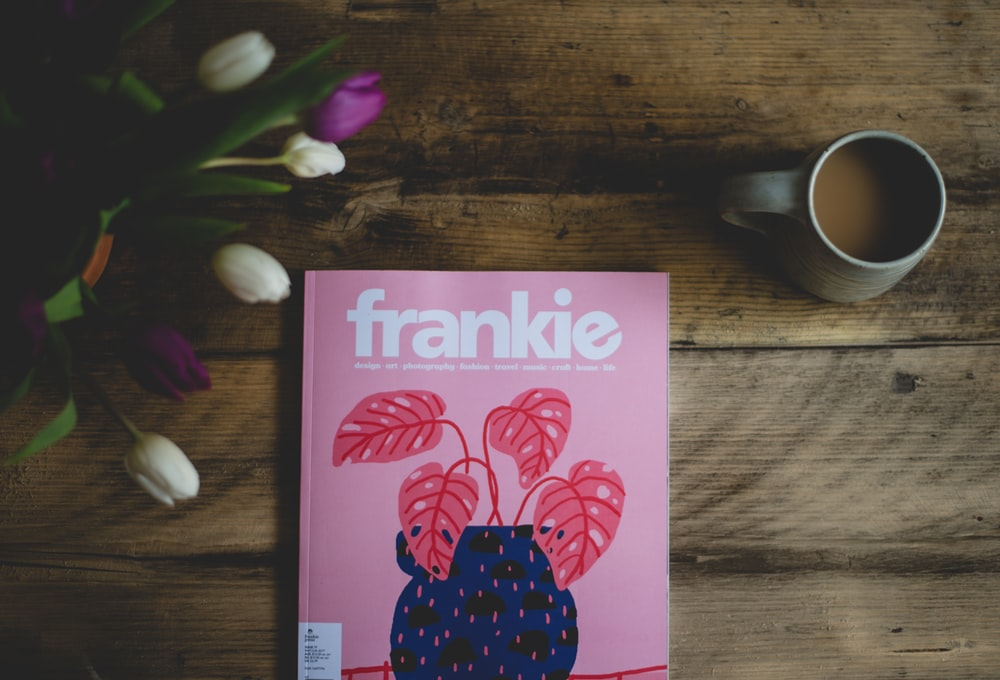 Frankie book near a cup of coffee