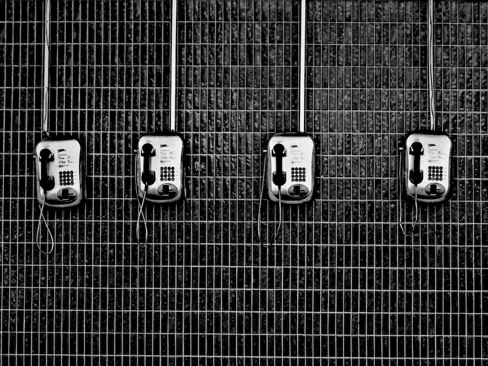four black-and-grey telephones