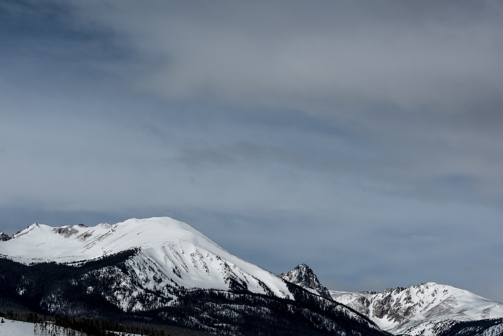 grayscale photo of mountain covered with snow