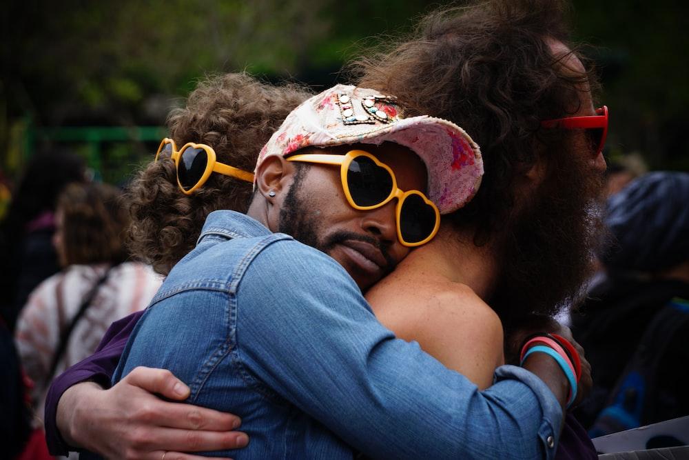 man hugging other man's back