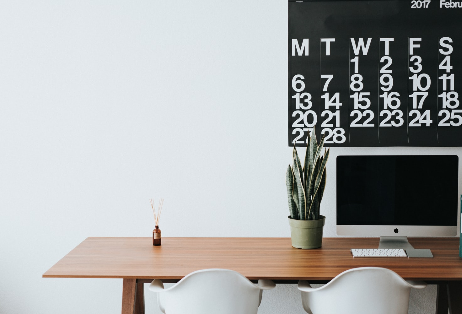 Desk with calendar and computer-Photo by Roman Bozhko on Unsplash- PersonalProfitability.com