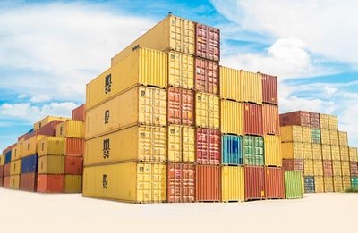 assorted-color filed intermodal containers transportation zoom background