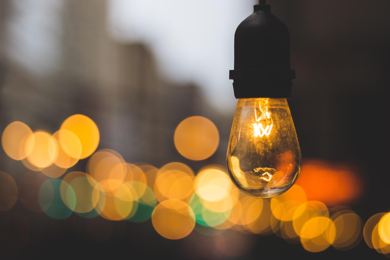 macro photography of yellow light bulb