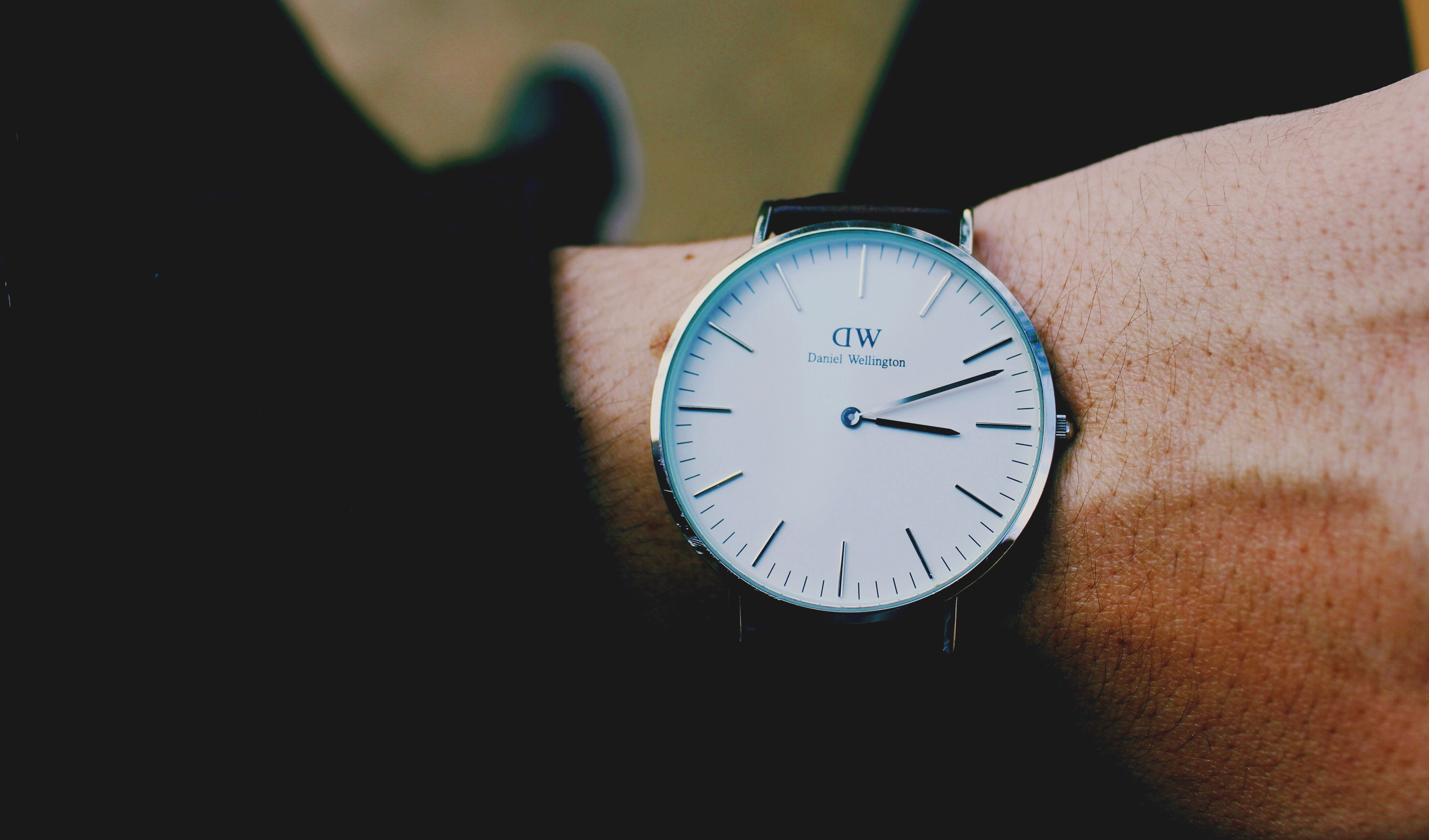 round silver-colored watch time at 3:11