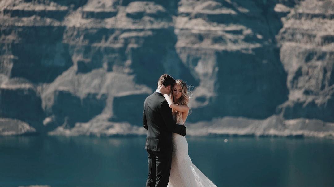 Wedding couple hug on cliff