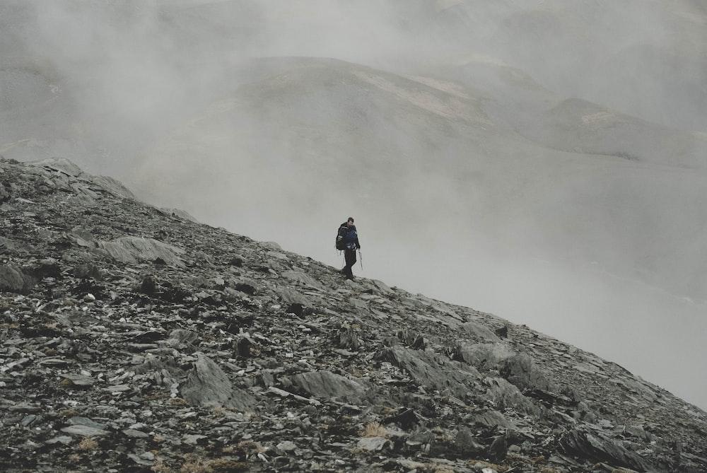 mountaineer climbing down on mountain