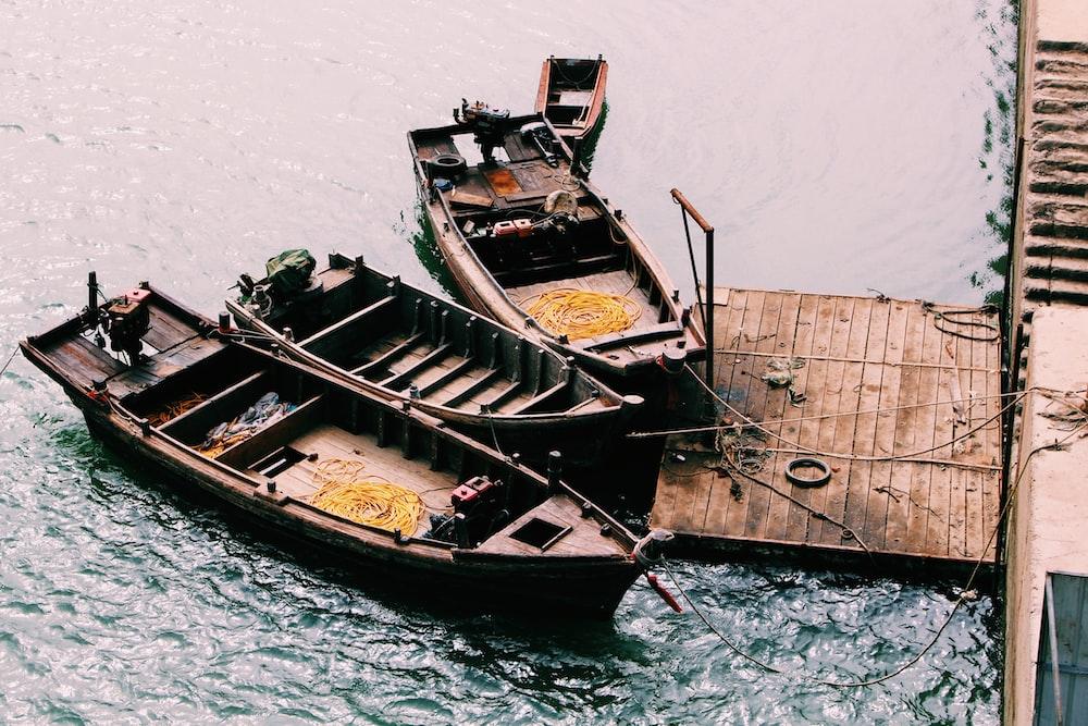 three boats tied on dock