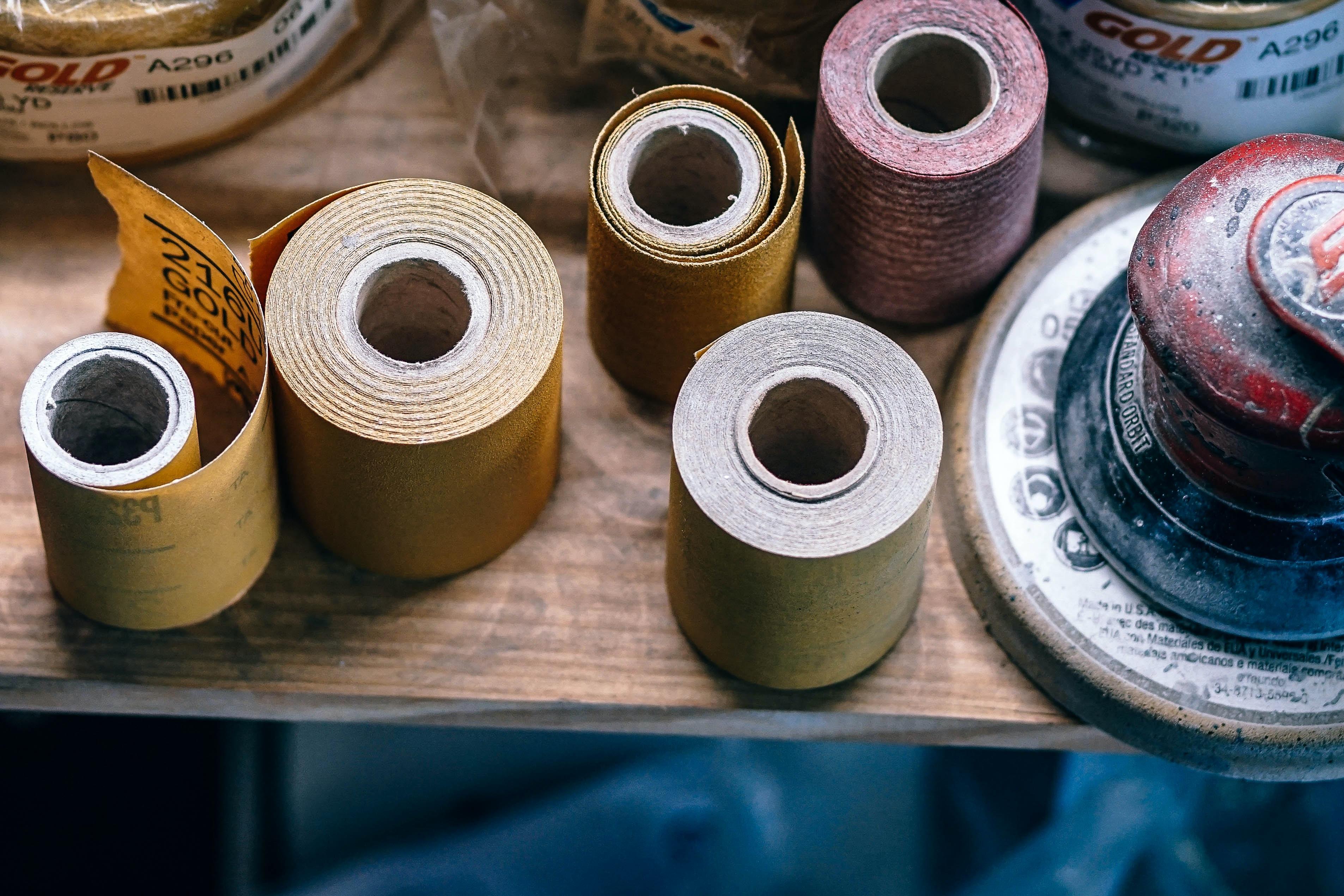 several assorted-colored sandpaper rolls