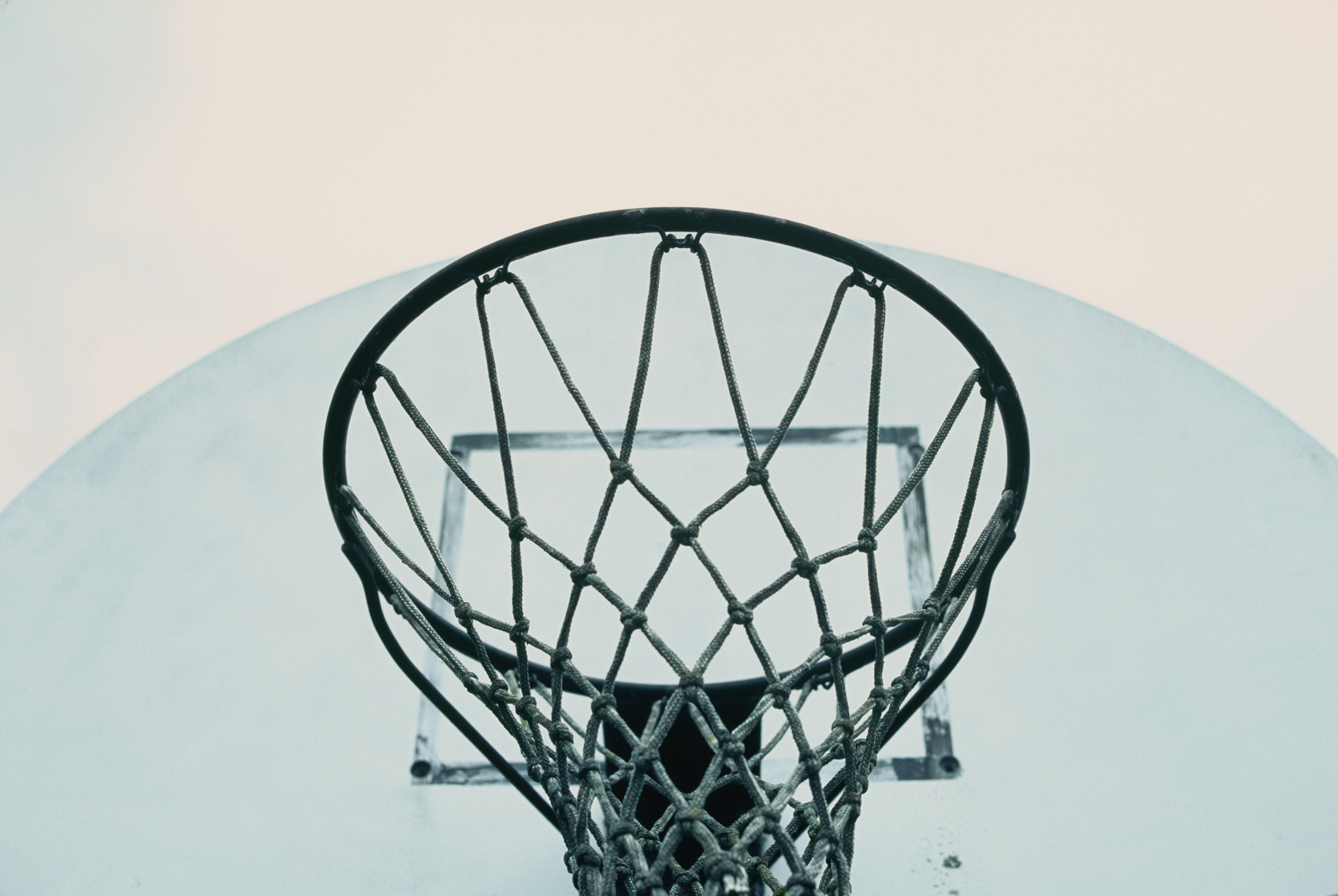 A macro shot from underneath a basketball hoop in on outdoor court in Long Grove