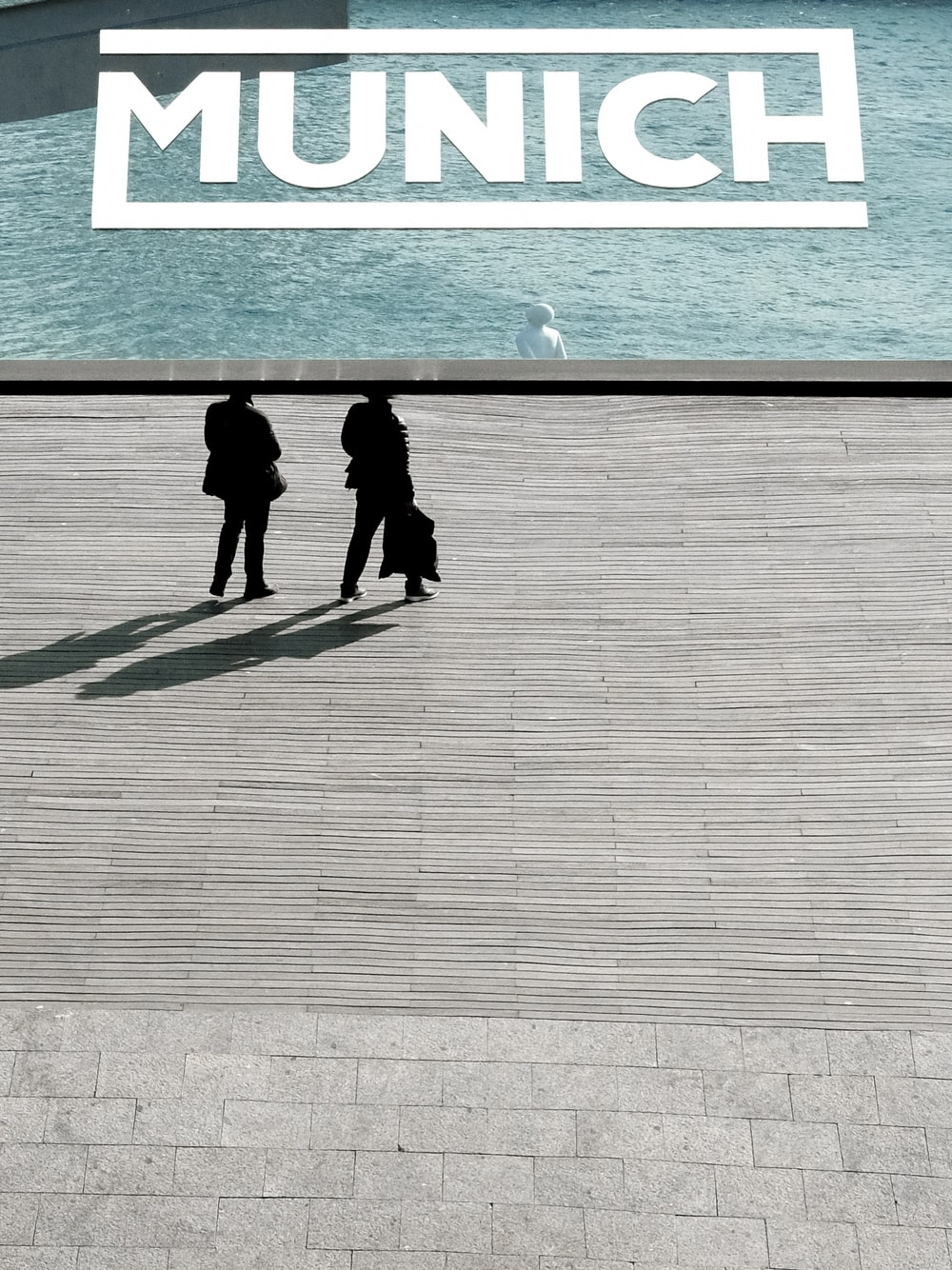 two person standing near body of water