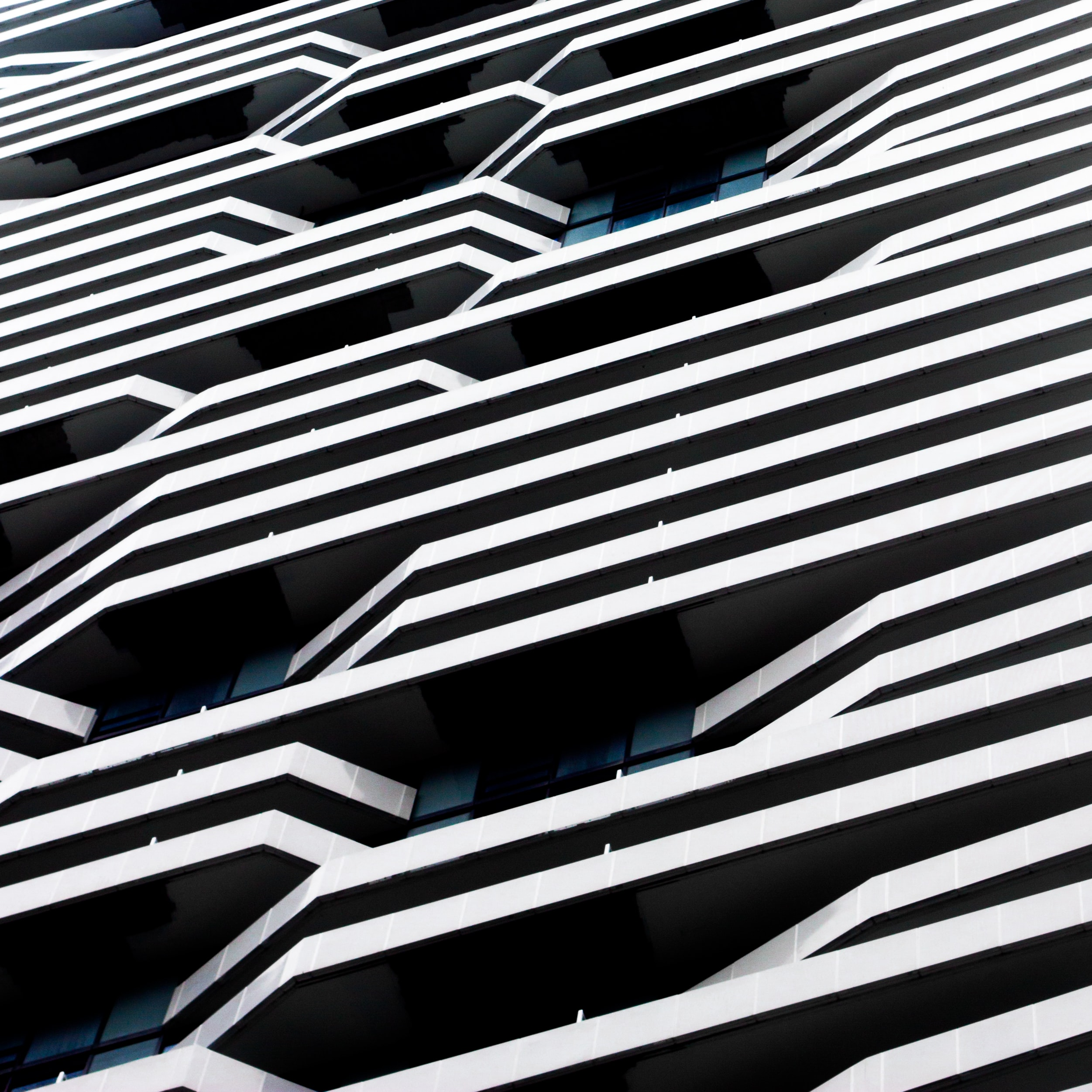 Black and white macro of modern line building architecture with windows in Toronto